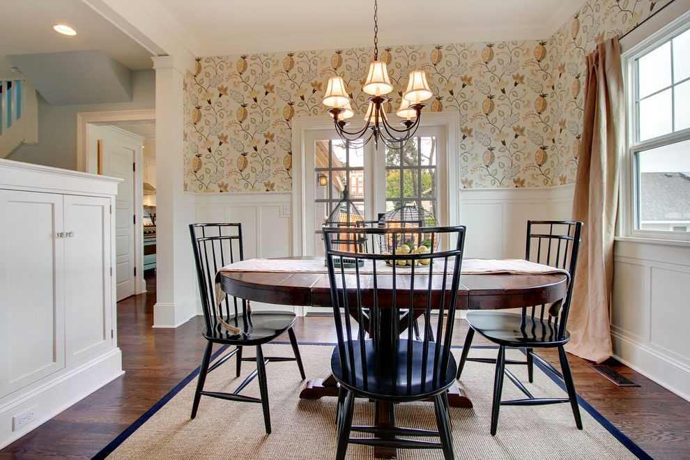 Andersons Nursery   Farmhouse Dining Room  and Area Rug Black Chandelier Craftsman Farmhouse French Doors Recessed Panel Sisal Spindle Chairs Wainscot Wallpaper Window Treatment Wood Floor
