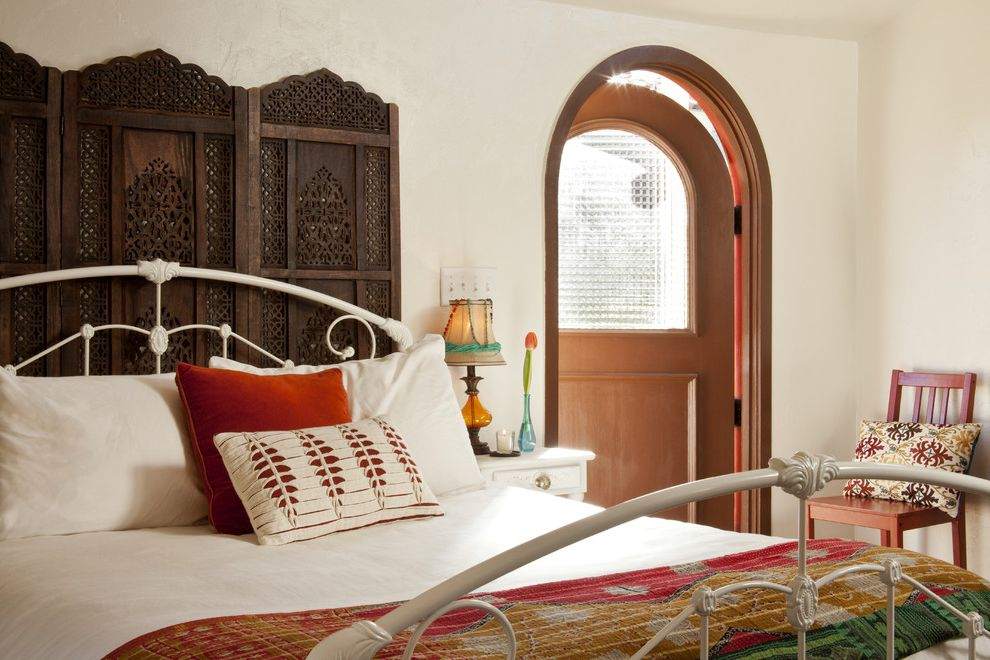 Angled Headboard   Eclectic Bedroom Also Arch Door Dark Wood Divider Dark Wood Room Partition Divider Headboard Red Accents Red Side Chair Screen Headboard White Bedding White Iron Bed White Nightstand White Walls Wood Arch Door