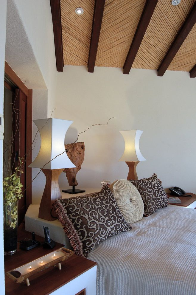 Angled Headboard   Tropical Bedroom  and Headboards Lighting Natural Sliding Window Storage Headboard Textured Ceiling Textured Walls Textures Thatched and Beamed Ceiling Thatched Roof