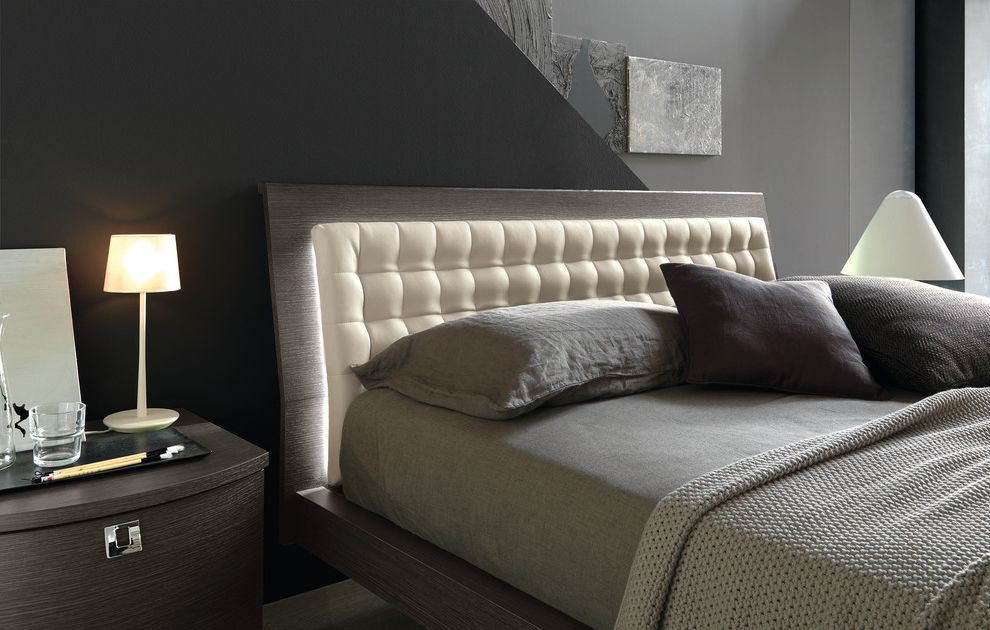 Angled Headboard with Contemporary Bedroom Also Back Lighting Backlit Bed Linens Cream Gray Ivory Nightstand Purple Table Lamp Tufted Headboard Unique Bed