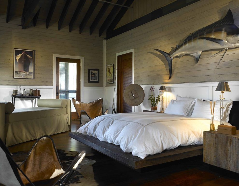 Angled Headboard with Eclectic Bedroom Also Butterfly Chair Beige Chaise Lounge Cowhide Chair Potted Plant Rustic Wood Nightstand Rustic Wood Platform Bed Swordfish Art Table Lamp Vaulted Ceiling Wall Art White Wainscoting Wood Beams Worn Wood Wall