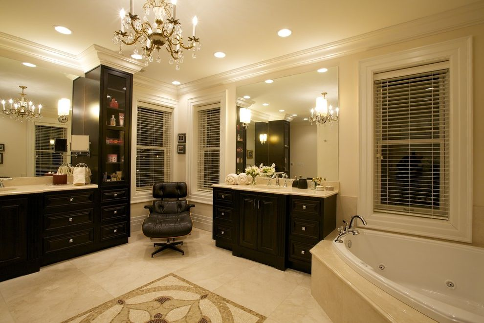 Annapolis Ob Gyn   Traditional Bathroom  and Black Cabinet Blinds Crystal Chandelier Eames Lounge Chair Eames Ottoman Garden Tub Jacuzzi Large Mirror Majestic Master Bathroom Recessed Lighting Relaxing Sconces Tan Marble Tile Rug Tranquil
