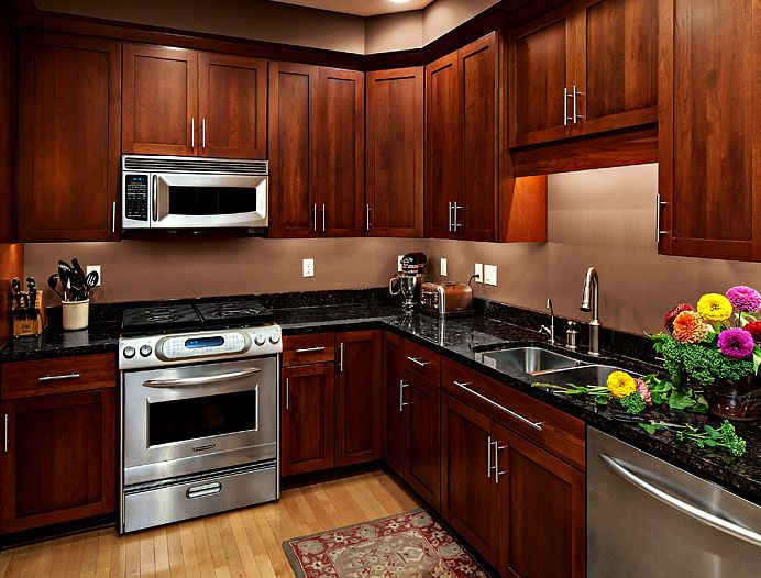 Annie Mac Mortgage   Contemporary Kitchen Also Black Counter Black Countertops Cherry Cabinets Cherry Kitchen Cherry Kitchen Cabinets Shaker Kitchen Cabinets Stainless Steel Hardware Stainless Steel Pulls