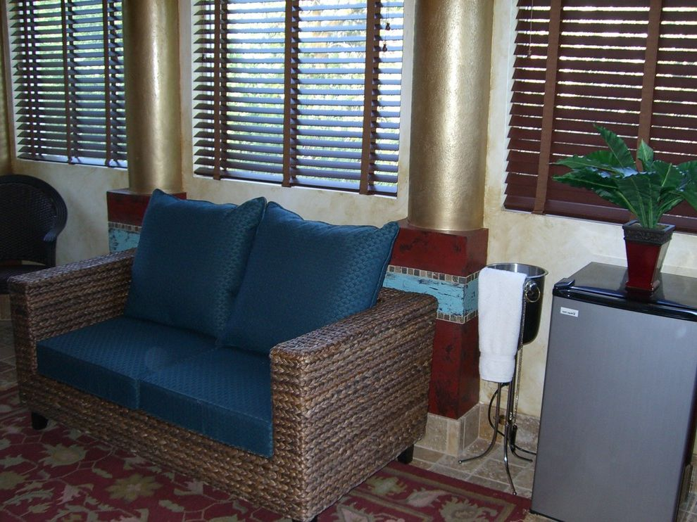 Anniversary Inn Logan   Eclectic Living Room  and Columns Couch Faux Finishes Gold Leaf Rug
