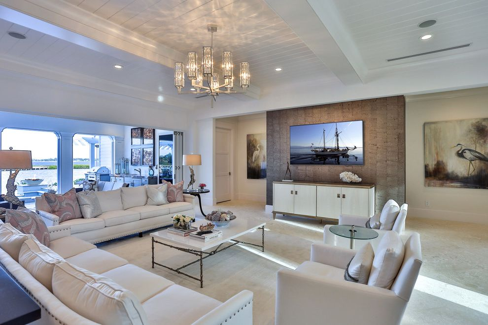 Antique White Tv Console with Transitional Family Room and Al Fresco Living Chandelier Floridian Villa Golf Course Living Indoor Outdoor Luxurious Cottage Open Air Living Slatted and Beamed Ceiling Upscale Cottage White Chairs White Console White Sofa