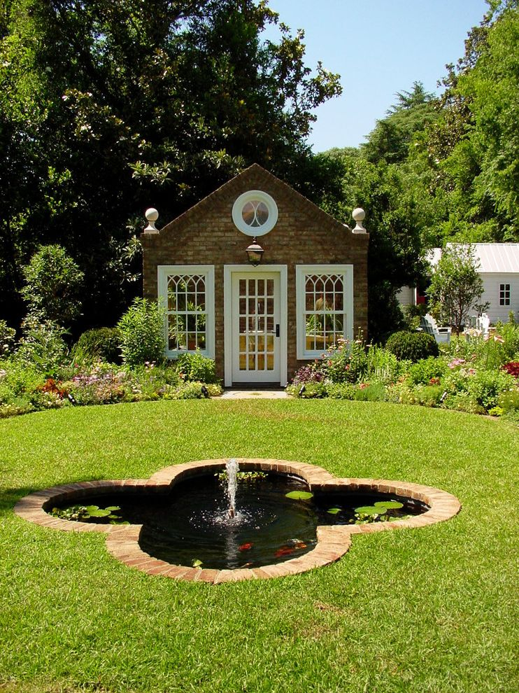 Apple Store Augusta Ga with Traditional Shed  and Brick Flowers Fountain Garden Garden Shed Greenhouse Koi Lawn Potting Shed Quatrefoil Round Window White Trim