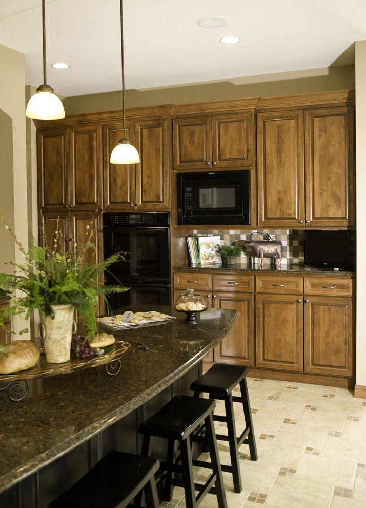 Appliance Discount Warehouse   Traditional Kitchen Also Barstool Black Custom Cabinets Dark Stone Dark Stone Countertop Light Tiled Floor Pendant Light Tiled Backsplash Tiled Floor Wood Cabinets