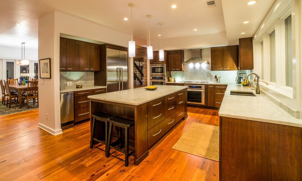Appliance Repair Longmont with Contemporary Kitchen  and Barstools Drawer Pulls Kitchen Appliances Kitchen Cabinets Kitchen Island Marble Countertop Pendant Lighting Thermador Tray Ceiling Wood Cabinets Wood Floors