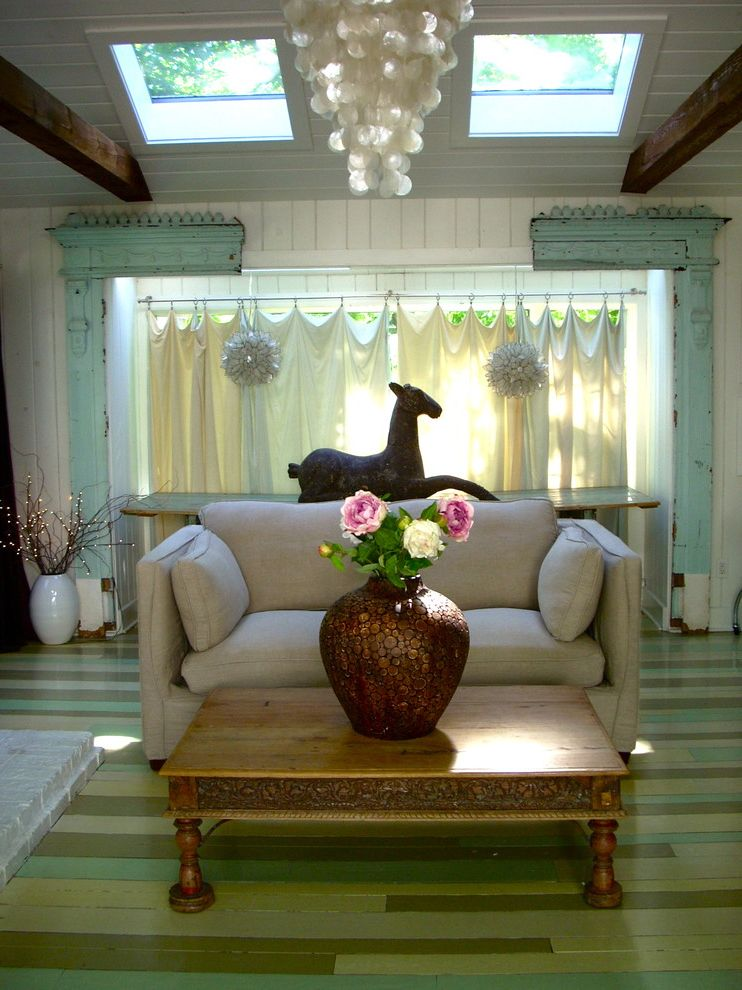 Architectural Salvage Mn   Eclectic Family Room Also Beams Carved Wood Chandelier Coffee Table Curtain Panel Green Love Seat Salvage Wood Sky Lights Striped Wood Floor Vaulted Ceiling White Painted Wood Walls Wood Paneling