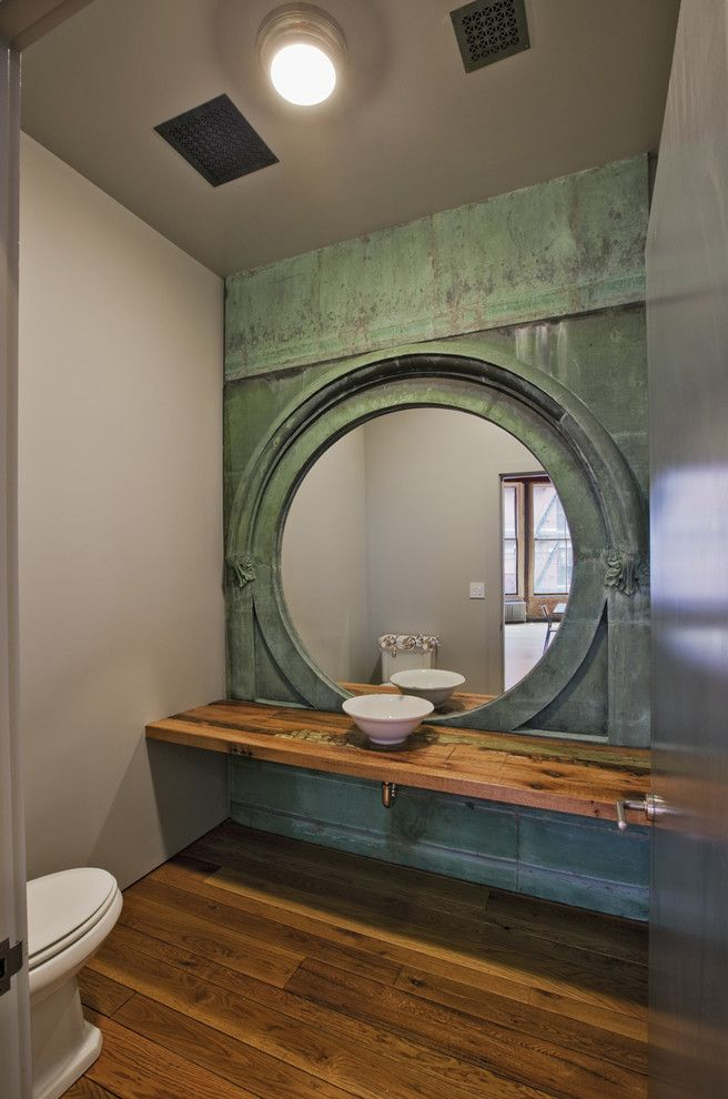 Architectural Salvage Mn with Industrial Powder Room Also Ceiling Vents Green Hardwood Flooring High Ceilings Large Mirror Marble Mirror Reclaimed Wood Round Round Mirror Sink Slab Stainless Tall Ceilings Vessel White Toilet White Vessel Sink Wood