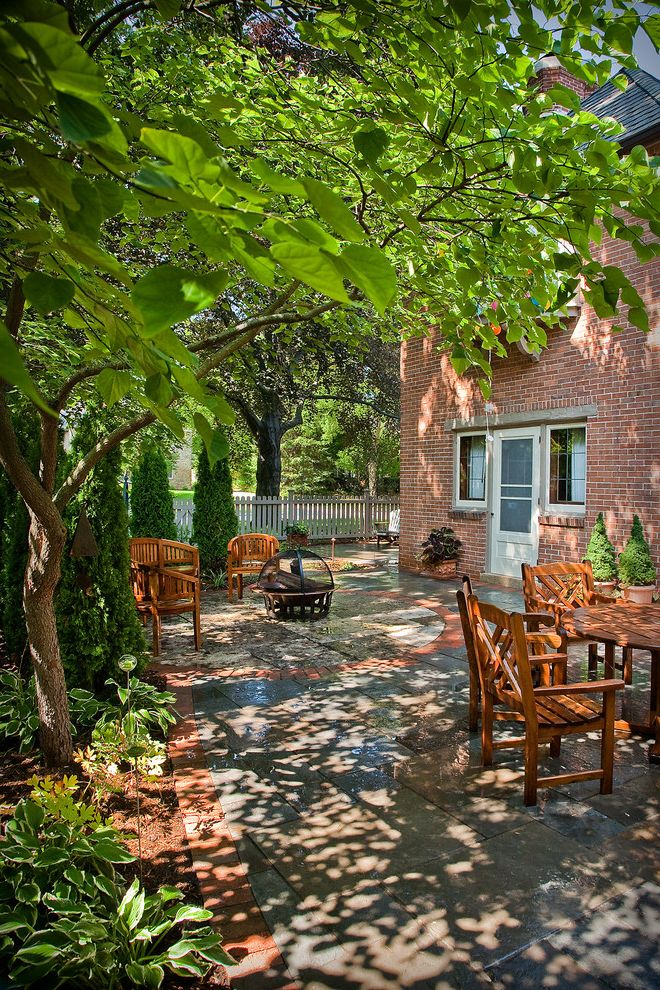 Argent Heating and Cooling   Traditional Patio Also Curb Appeal Garden Ideas Landscape Design Back Yard Brick Fire Pit Garden Natural Stone Outdoor Seating Outdoors Patio Picket Fence Shade Shadows Teak Teak Furniture Topiary