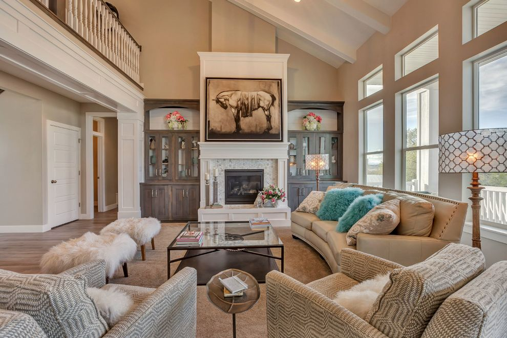 Arive Homes   Transitional Family Room Also Beige Built Ins Clerestory Window Curved Sofa Distressed Cabinets Equestrian Fireplace Glass Coffee Table Loft Ottoman Slanted Wall Teal White Trim