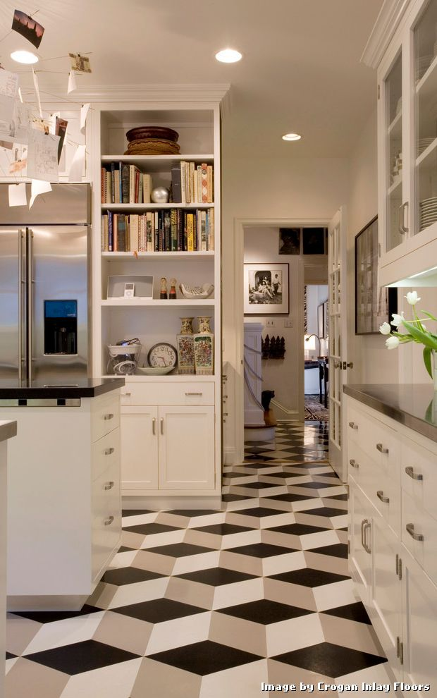 Armstrong Vinyl Floor Tiles with Modern Kitchen and Black and White Black Countertop Built in Chrome Hardware Entry French Door Geometric Pattern Floor Recessed Lights Stainless Steel Fridge Wall Art White Island White Shaker Panel Cabinets White Wall