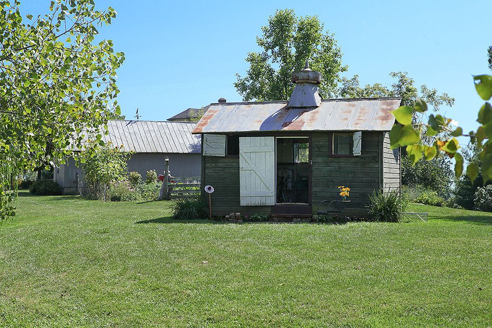 Art Van 14 Mile with Farmhouse Shed Also Diy Eclectic Exterior Farm Lawn Metal Roof Ohio Rural Rustic Rustic Shed Shed White Door White Shutters Wood Fence Worn Metal Roof Worn Shed