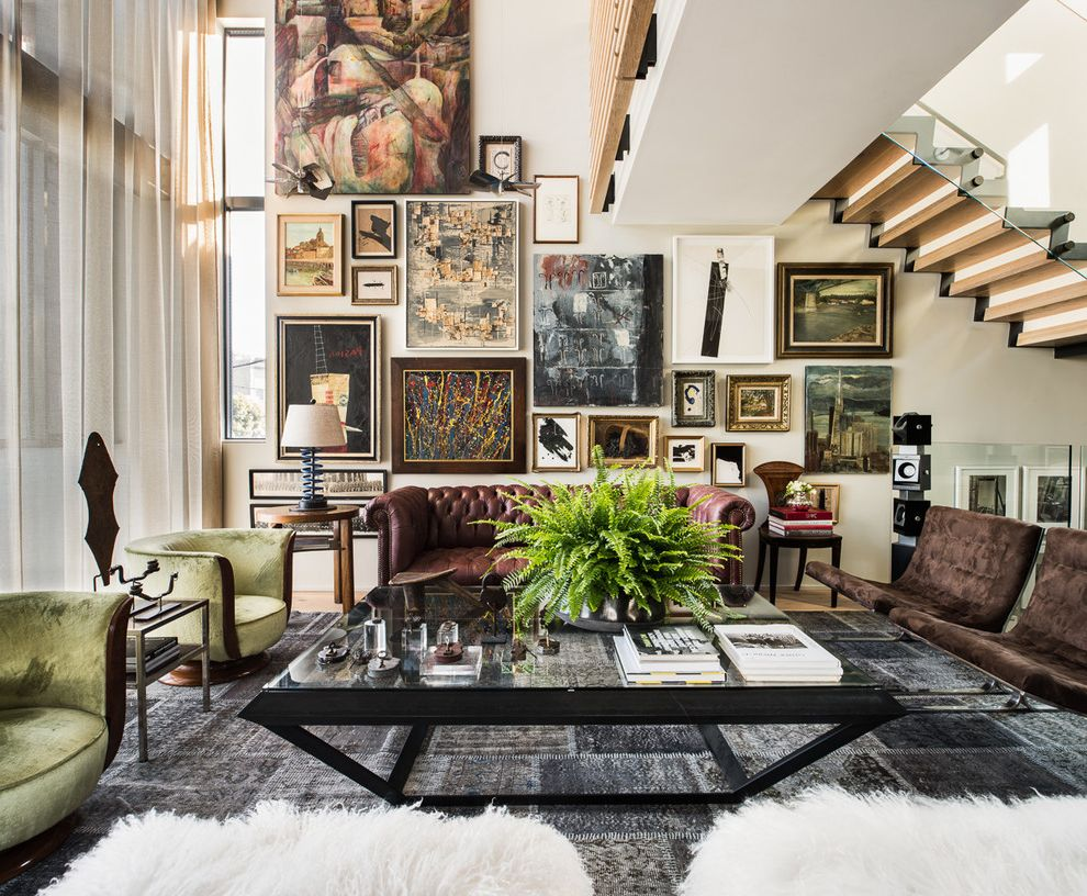 Art Van Furniture Locations   Eclectic Living Room  and Catwalk Chesterfield Sofa Elegant Floor to Ceiling Window Framed Wall Art Gallery Wall Gray Rug Green Armchair High Ceiling Large Coffee Table Loft Patchwork Rug Zigzag Staircase