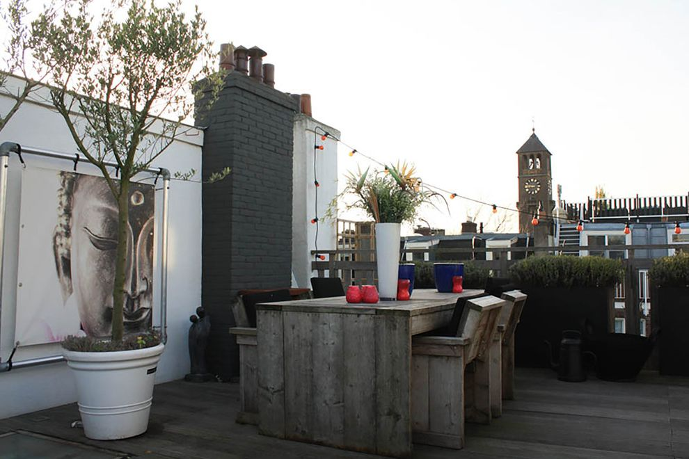 Art Van Furniture Locations with Eclectic Deck Also Al Fresco Dining Asian Artwork Black Brick Chimney City Outdoor Dining Table Potted Tree Roof Deck Rooftop Rustic Dining Chairs Rustic Wood Table String Lights Urban