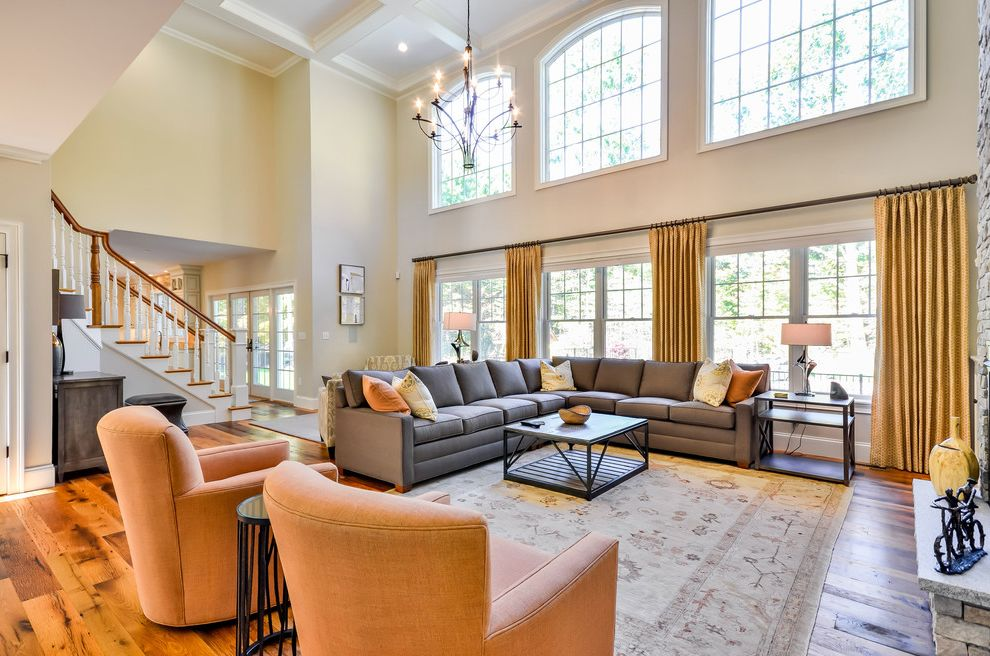 Ashbrook Furniture Nashua Nh   Traditional Family Room Also Arched Windows Area Rug Crown Molding Gray Sofa High Ceilings Wall Art Yellow Drapes