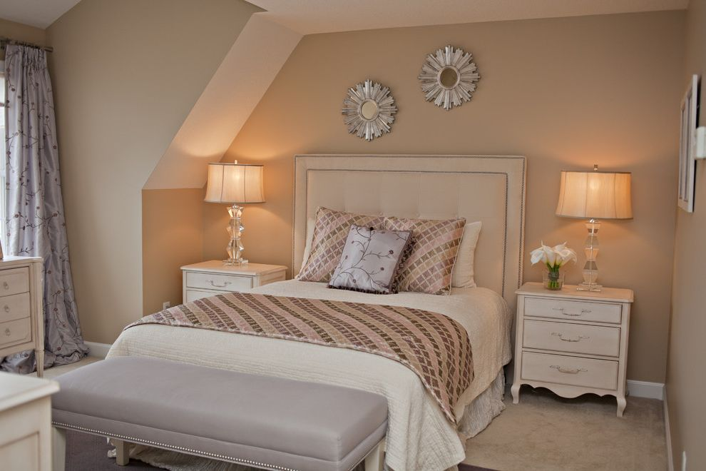 Ashley Furniture Davenport Iowa with Modern Bedroom Also Beige Bench Seat Carpeting Curtain Panel Nail Head Detail Nightstand Pillows Starburst Mirror Table Lamps Upholstered Headboard Vaulted Ceiling White Painted Wood Window Treatment
