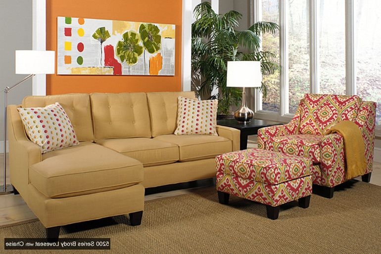 Ashley Furniture Davenport Iowa with Transitional Living Room  and Davenport Interior Designer Iowa Knilans Furniture Interiors Loveseat with Chaise Neutral Rug Orange and Gray Wall Orange Wall Tufted Back Loveseat Upholstered Chair and Ottoman