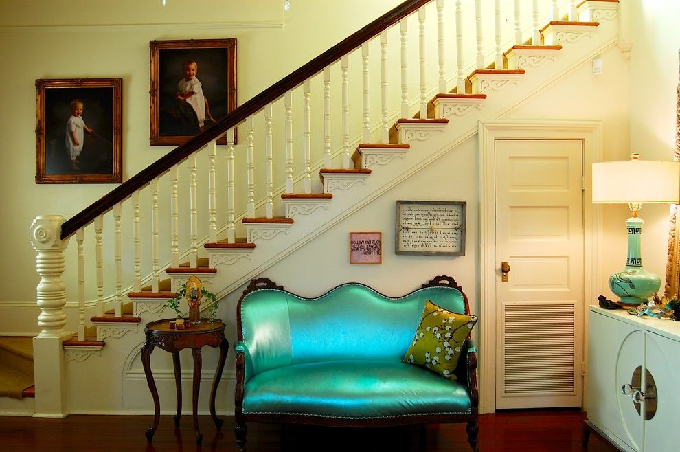 Ashley Furniture Loveseat Recliner with Victorian Staircase  and Beige Railing Beige Stair Railing Beige Wall Contemporary Dark Wood Floor Eclectic Entry Gold Frame Green Sofa Green Table Lamp Staircase Wood Side Table Wood Staircase Wood Stairs