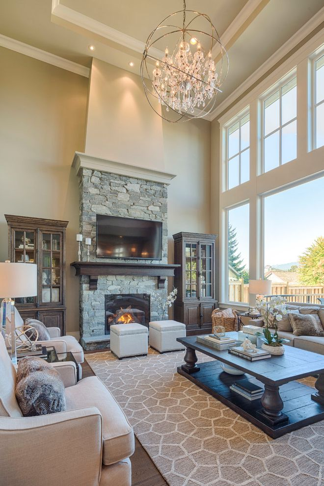 Ashley Furniture Sacramento   Traditional Living Room  and Award Winning Builder Crystal Chandelier Dark Wood Coffee Table High Ceilings Real Stone Tray Ceiling Tv Over Fireplace Two Story Great Room