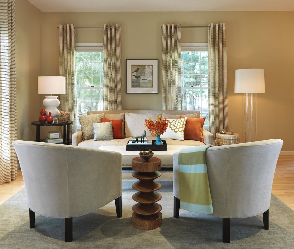 Ashley Furniture Side Tables   Transitional Living Room  and Corkscrew Curved Chair Drapes Glass Floor Lamp Ice Blue Light Gray Orange Printed Curtains Tray Upholstered Coffee Table Wood Side Table