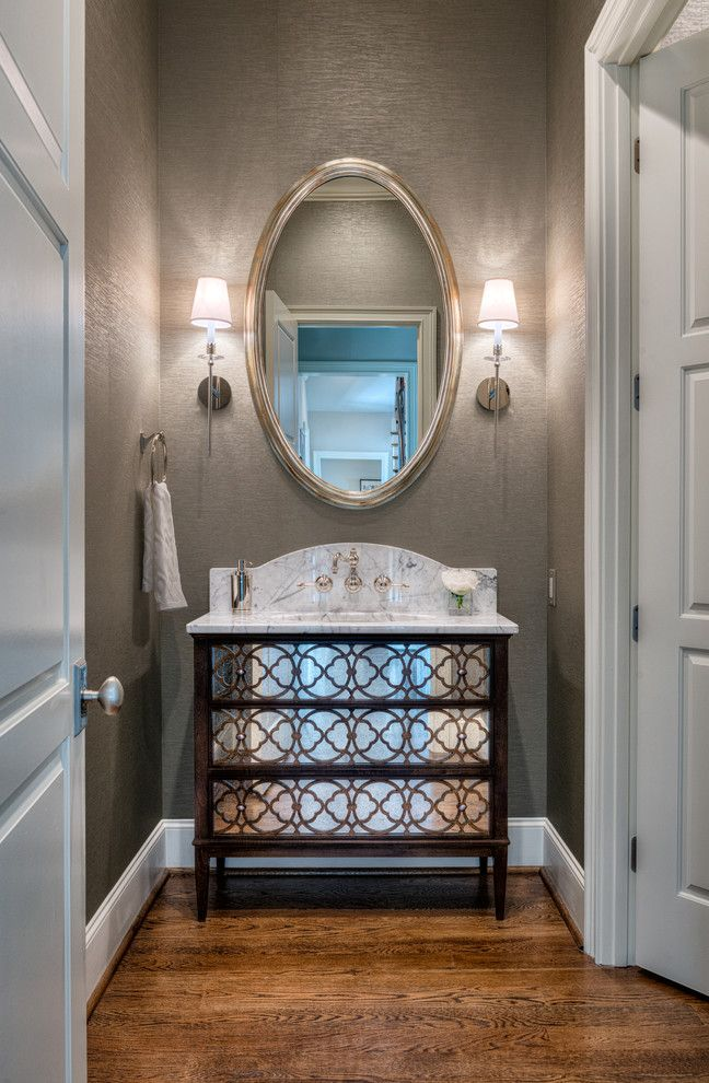 Ashlyn Furniture with Transitional Powder Room  and Marble Marble Countertop Metallic Wallpaper Oval Mirror Polished Nickel Fixtures Powder Room Sconces Tracery Chest Wall Paper