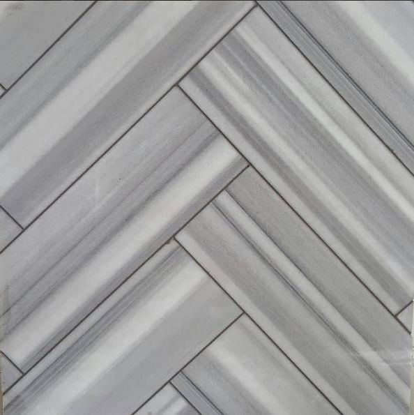 Atlas Tile and Stone    Spaces  and Fluid Herringbone Pattern Natural Stone
