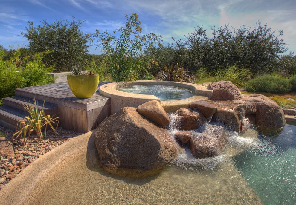 Austin Springs Spa   Southwestern Pool  and Boulder Deck Desert Dry Landscape Grasses Hot Tub Lime Planter Oasis Pebbles Pool Potted Plant