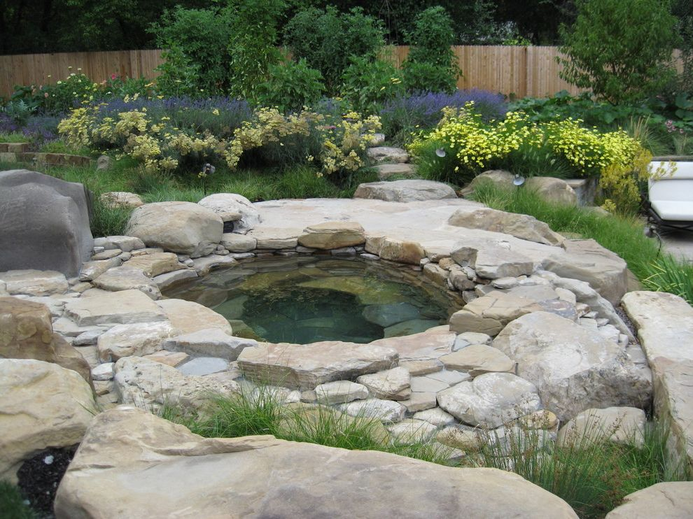 Austin Springs Spa with Rustic Pool  and Boulders Flowers Grasses Hot Tub Ornamental Grasses Outdoor Chaise Lounges Path Patio Lounge Chair Stacked Stone Stone Slabs Stone Steps Walkway Wood Fence