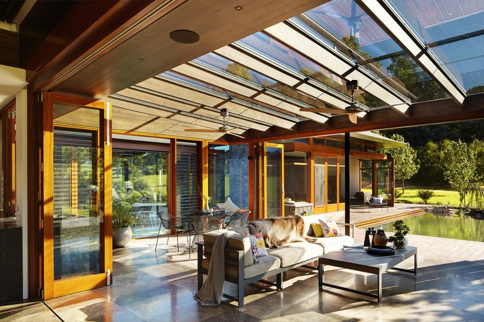 Auto Glass Unlimited with Asian Sunroom and Bifold Doors Ceiling Fan Indoor Outdoor Living Natural Light Patio Dining Furniture Patio Furniture