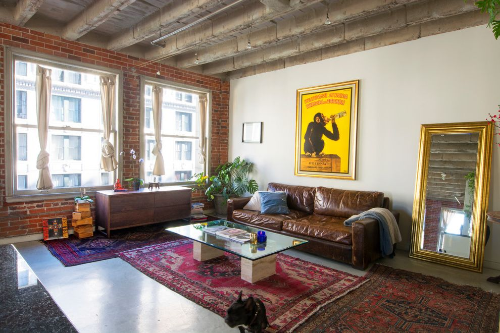 Avalon Apartments Los Angeles   Industrial Living Room  and Brick Wall Brown Sofa Exposed Brick Leaning Mirror My Houzz Red Area Rug Wall Art