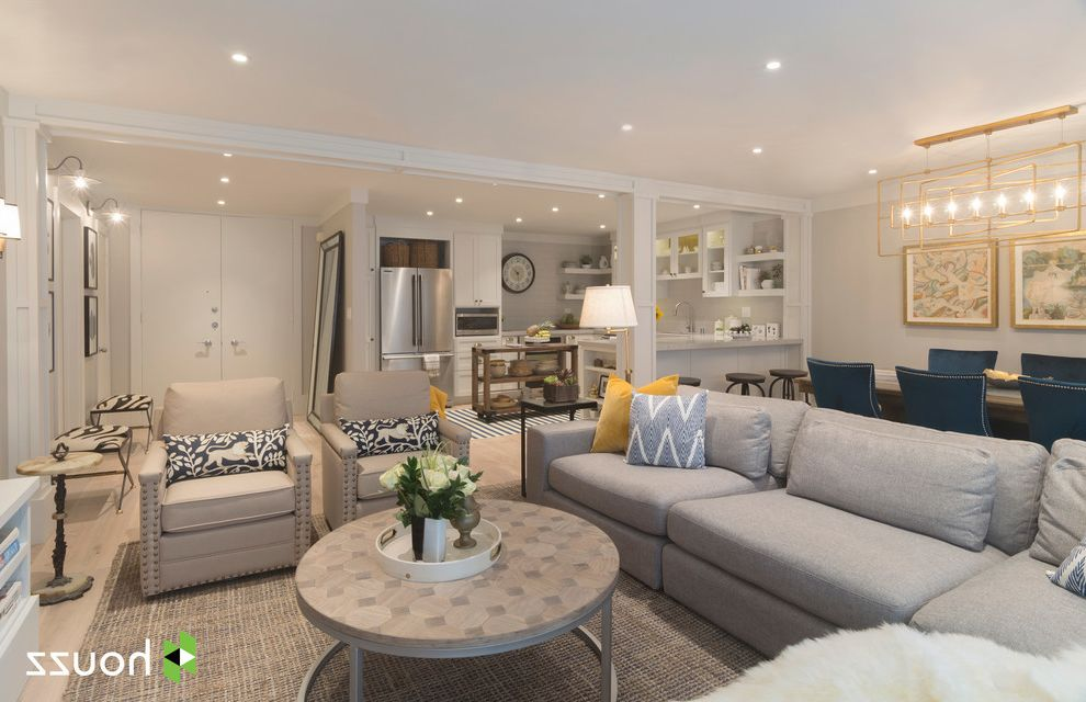 Avalon Apartments Los Angeles with Transitional Living Room Also Beige Armchairs Chevron Pillow Gray Sectional with Chaise Nailhead Trim Patterned Pillows Round Coffee Table Round Side Table Zebra Stools