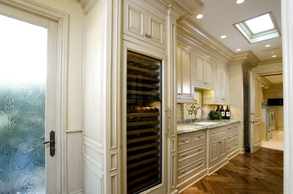 Avanti Dual Zone Wine Cooler with Traditional Kitchen  and Beverage Cooler Custom Woodwork Herringbone Wood Floor Marble Counters Raised Panel Cabinets Recessed Lights Sky Light Specialty Glass Wine Storage