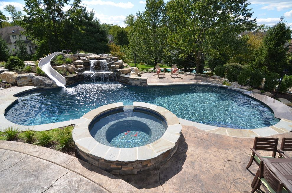 Average Cost of Inground Saltwater Pool   Traditional Pool  and Adirondack Chairs Boulders Concrete Paving Grasses Hot Tub Monogram Organic Shaped Pool Patio Furniture Pool Saltwater Pool Spa Stone Coping Water Feature Waterfall Waterslide