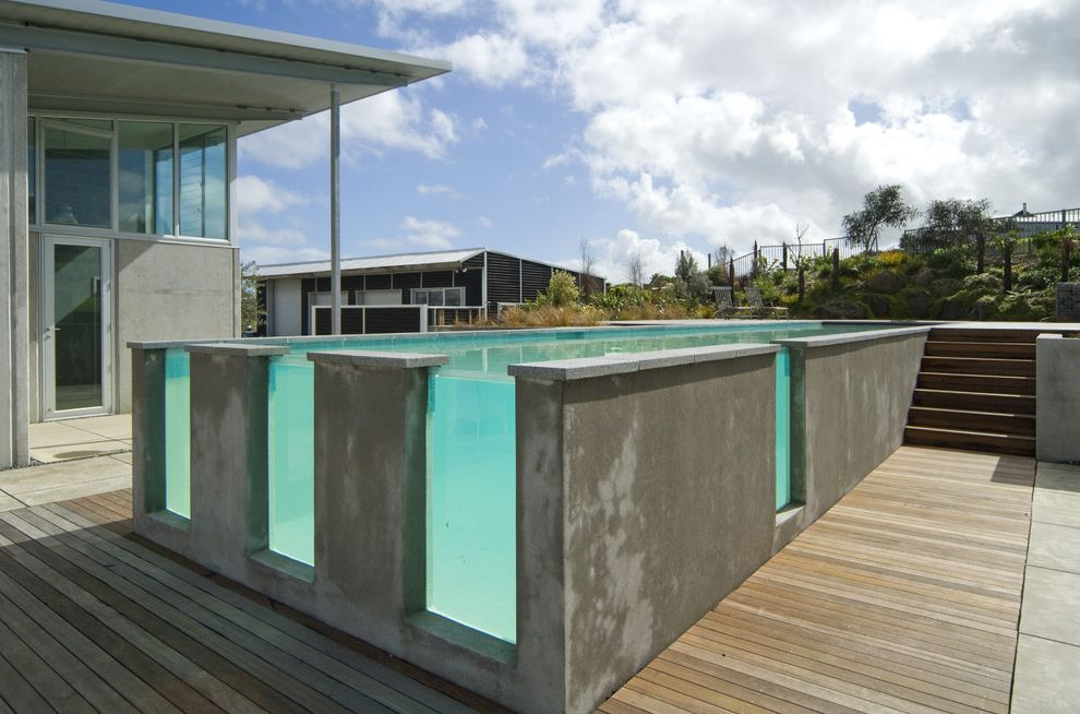 Average Cost of Inground Saltwater Pool with Contemporary Pool  and Concrete Concrete Exterior Elevated Pool Glass Panel Glass Wall in Outdoor Pool Raised Swimming Pool Unique Pool Wood Patio Wood Stairs