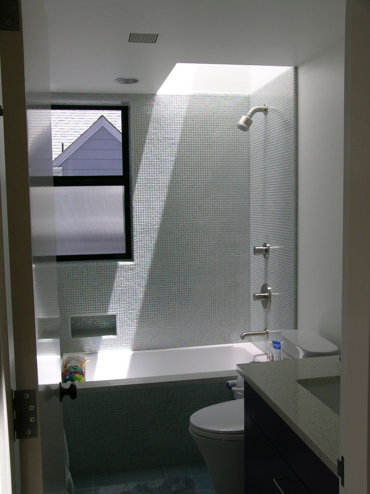Average Cost to Remodel a Small Bathroom   Contemporary Bathroom  and Bath Blomberg Window Duravit Undermount Tub Glass Tile Glass Tile Tubshower Walls Icestone Lav Counter Modern Narrow Reed Glass Painted Lav Cabinet Skylight Tub Window