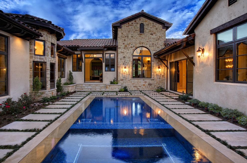 Avie Med Spa with Mediterranean Pool Also Dark Window Trim Grass Patio Pavers Pool Floor Design Stacked Stone Steps Stone Walls Tile Roof Turret Wood Trim