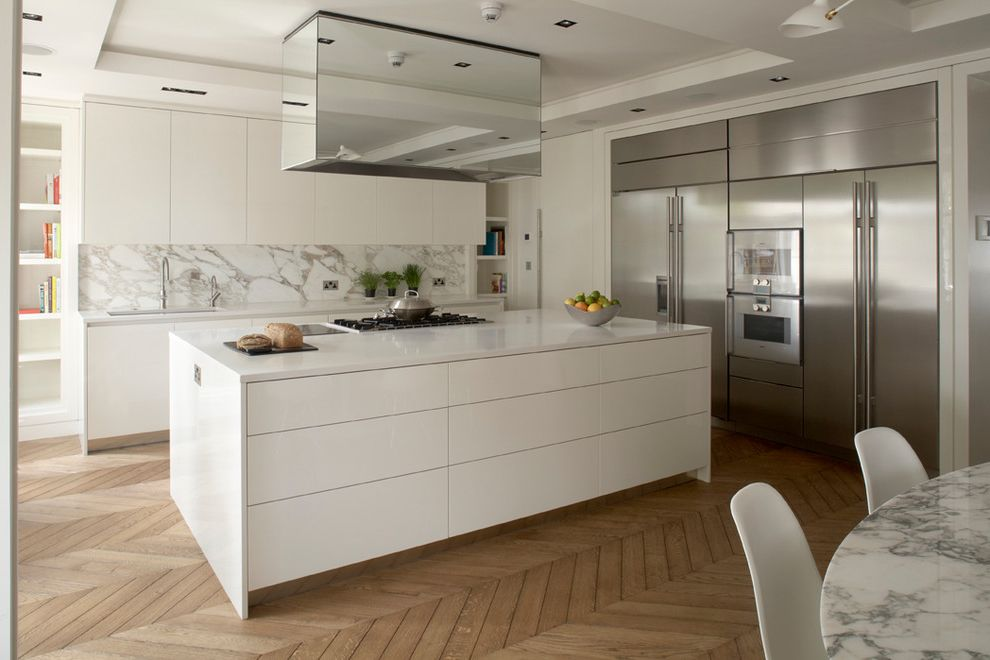 Aztec Appliance   Contemporary Kitchen Also Herringbone Floor Island Hood Joinery Kitchen Design Marble Backsplash Mirrored Hood Modern Natural Wood Floor Roberttimmons Tray Ceilings Two Refrigerators White White Kitchen Island