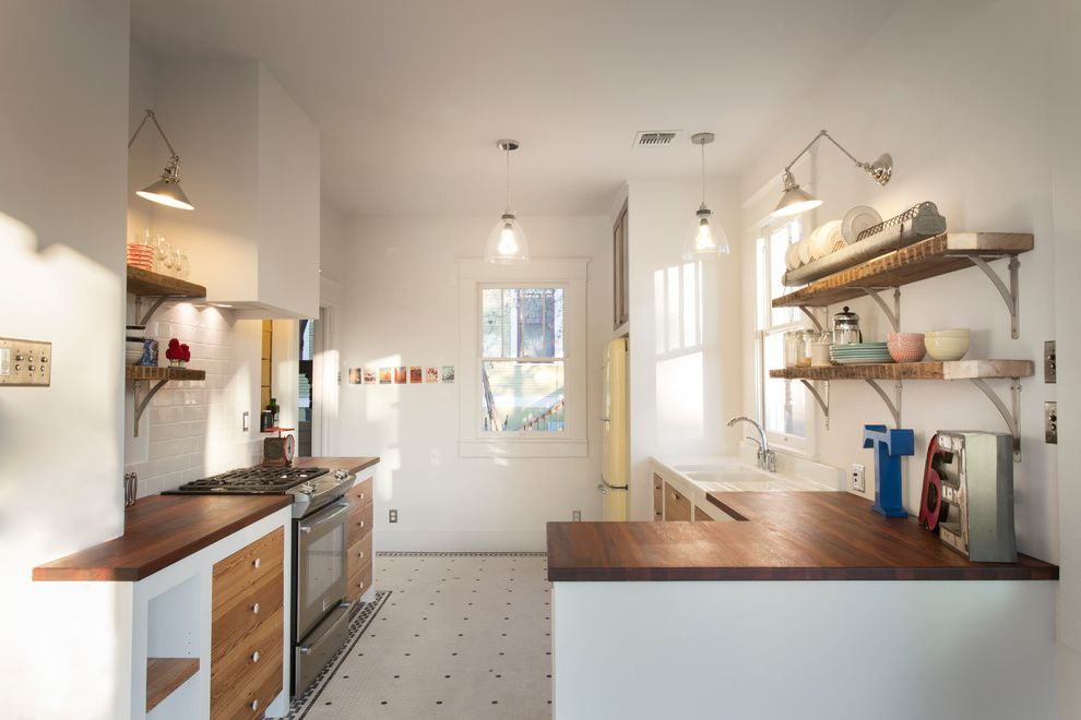 Aztec Appliance with Eclectic Kitchen  and Black and White Tile Floor Inset Drawers Kitchen Peninsula Light Yellow Fridge Open Shelving Retro Fridge Retro Kitchen Small Kitchens Ideas Stainless Range Vintage Kitchen Wood Countertop