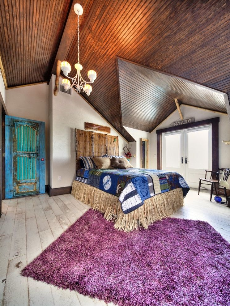 Aztec Grass with Eclectic Bedroom Also Area Rug Bed Bedding Chandelier Colorful Cottage Distressed Hawaiian Island Sloped Ceiling Tropical Vintage Wood Floor Wood Paneled Ceiling
