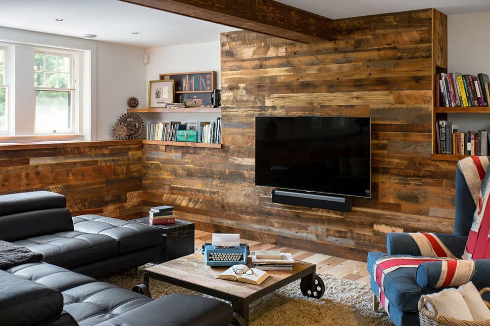 B Dry Basement   Industrial Basement  and Basement Remodel Black Sectional Sofa Boxcar Planks Industrial Coffee Table Industrial Style Mixed Softwood Blend Open Shelves Reclaimed Wood Rolling Coffee Table Wood Walls