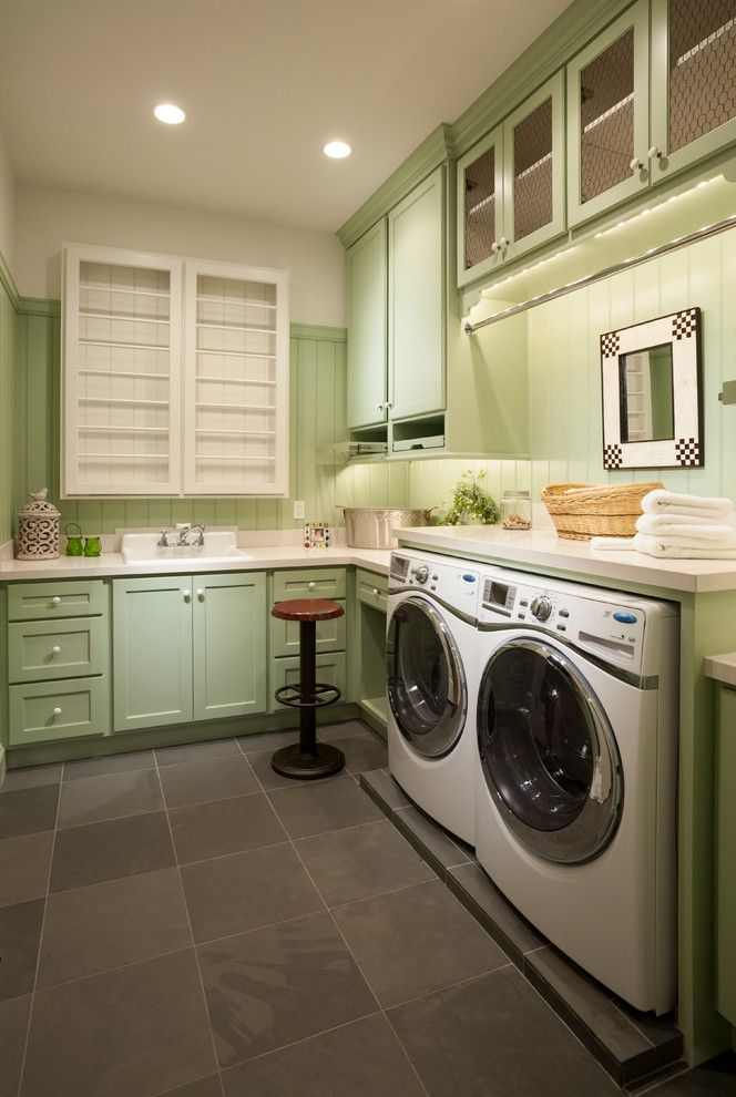 B Dry Basement with Traditional Laundry Room  and Green Cabinets Green Wainscoting Recessed Panel Cabinets Stone Floor Tile Swivel Stool Tongue and Groove White Pulls