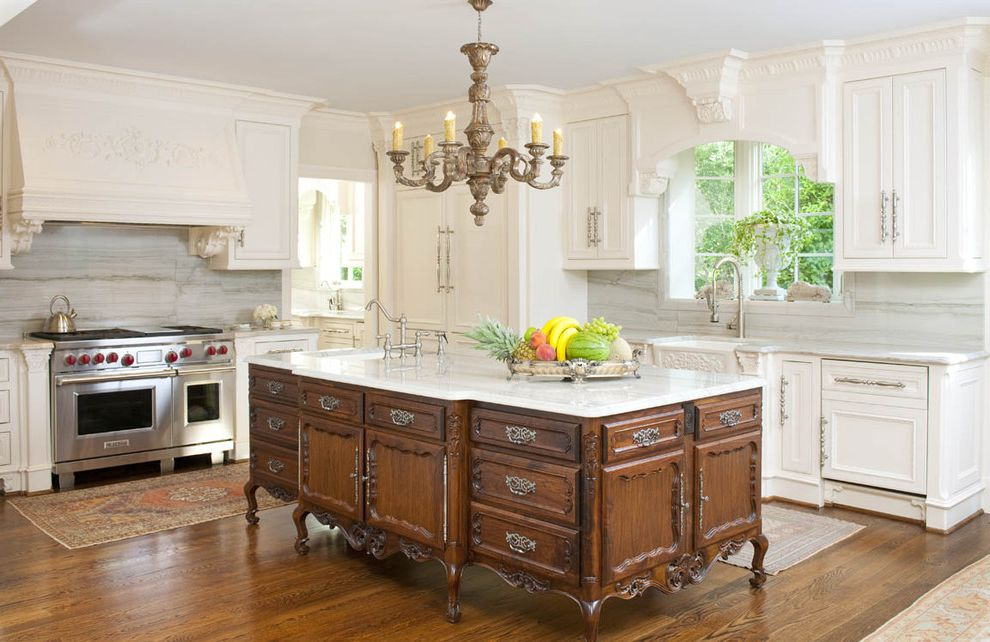 Baileys Furniture with Victorian Kitchen  and Cabinet Front Refrigerator Chandelier Kitchen Island Kitchen Rugs Oriental Rug Panel Refrigerator Quartzite Countertops Range Hood Stainless Teel Appliances Two Tone Cabinets White Kitchen Wood Flooring