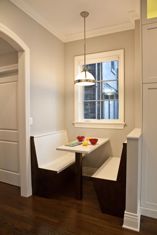 Balboa Mist Paint   Transitional Kitchen  and Banquette Baseboards Breakfast Nook Built in Seating Dark Floor Pendant Lighting Utility Pendant White Wood Wood Flooring Wood Molding