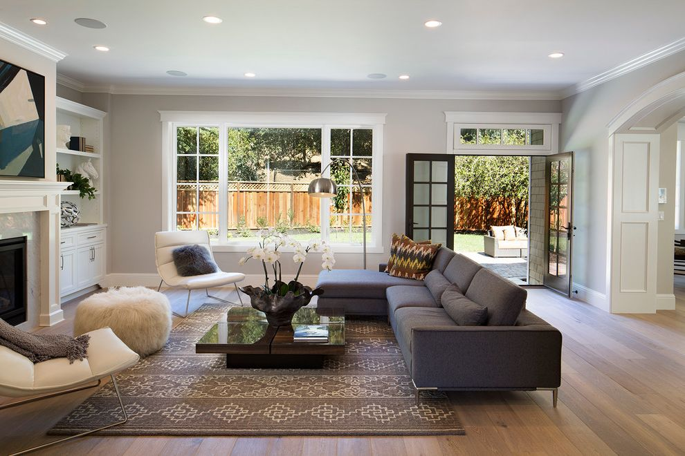 Balboa Mist Paint   Transitional Living Room Also Arched Doorway Decorative Throw Pillows Furry Pouf Gas Fireplace Glass Doors Gray Sofa Recessed Lighting Transom Window White Chairs