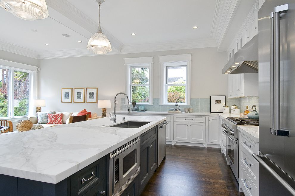 Balboa Mist Paint with Traditional Kitchen Also Custom Woodwork Frame and Panel Cabinets Gray Hood Island Marble Pendant Lights Stainless Steel White Counters White Painted Wood
