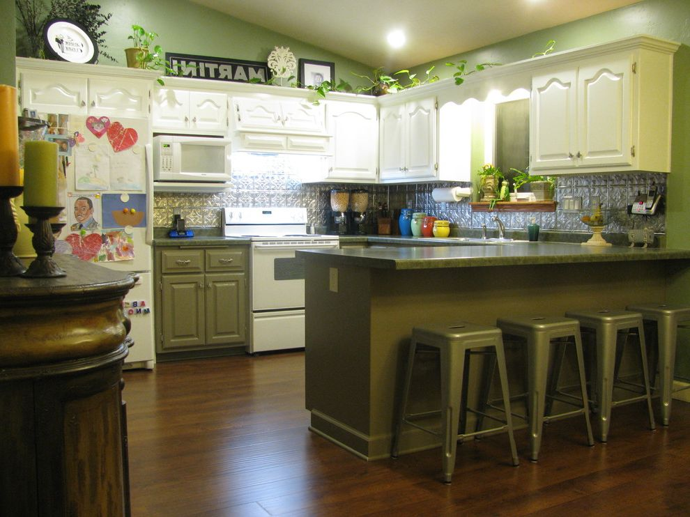 Balterio Laminate Flooring Reviews with Eclectic Kitchen  and Green Island Green Kitchen Kitchen Laminate Plank Floor Metal Stools Painted Oak Cabinets Silver Backsplash Tin Backsplash White Appliances White Cabinets