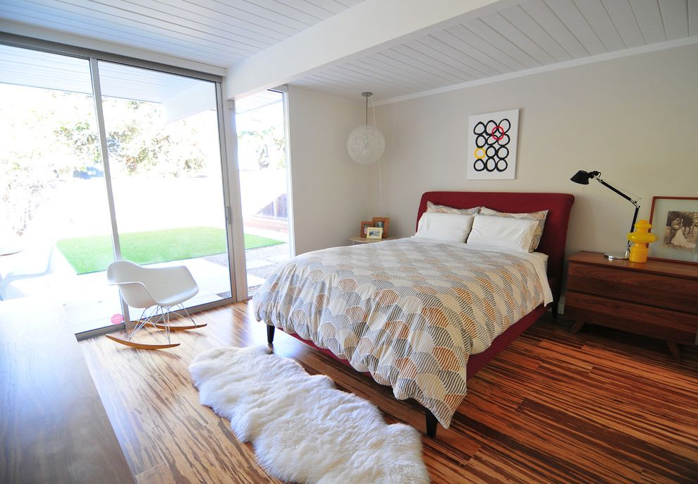 Bamboo Flooring Review with Midcentury Bedroom  and Beige Wall Eichler Fur Rug Globe Pendant Light Midcentury Modern Nightstand Patterned Bedding Rocking Chair Sliding Glass Door White Ceiling Beams White Wood Ceiling