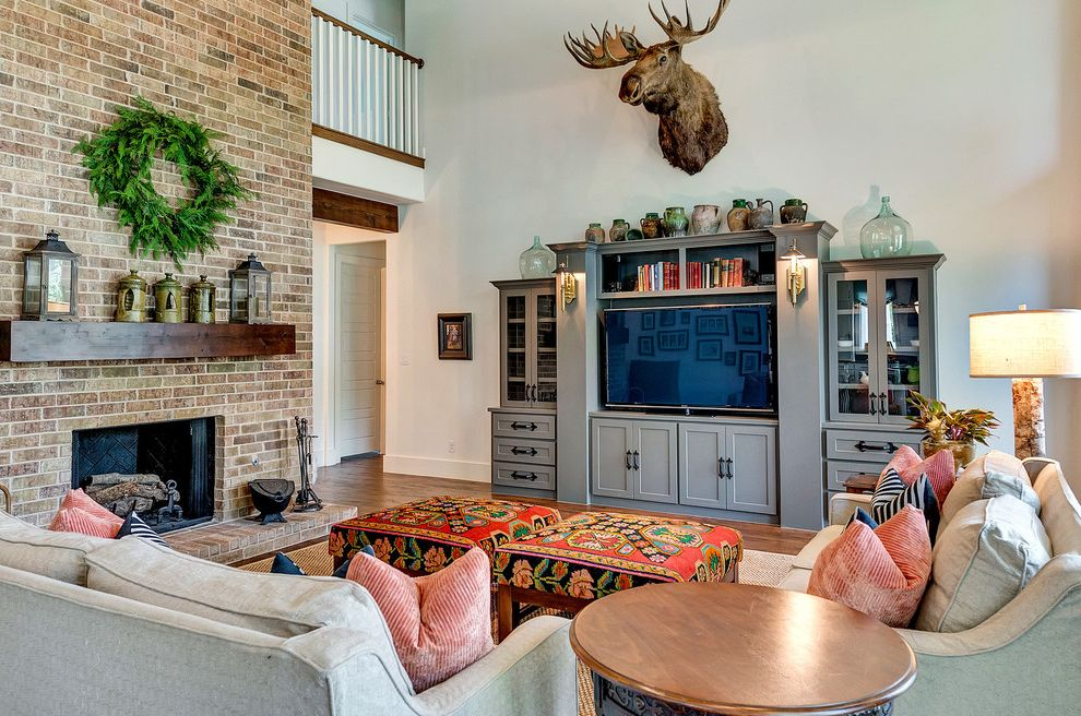 Bannister Custom Homes   Farmhouse Living Room Also Brick Fireplace Floor to Ceiling Brick Fireplace Modern Farmhouse Moose Head Patterned Ottoman Single Wood Beam Mantle Upholstered Ottoman Wood Beam Mantle